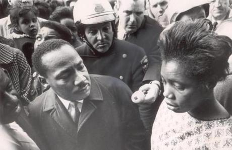 April 22, 1965: The Rev. Martin Luther King Jr. listened to Betty Jennings of Roxbury talk about the problems of living in a run-down apartment building, with broken windows and vermin infestation. After Jennings told King how her baby had become ill twice when the heat was turned off, he declared,