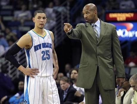 Hornets coach Monty Williams (right) is a close friend of Austin Rivers's father — which dad says is good and bad.