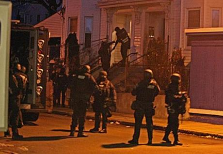 A Boston Police SWAT team secured a building on Langdon Street in Dorchester early Thursday.