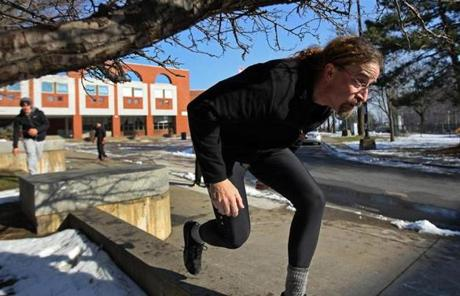 Participant David Kovin ducked under a tree branch while running on a wall.