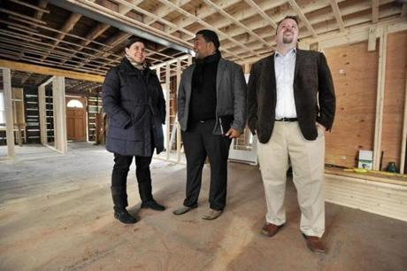 From left, Marina Hauser, Delince Louis, and Aaron Breen, co-founders of Beantown Property Group. LLC. stand in what will be the greatroom in the great room of a house in Winchester, now undergoing extensive rehabilitation and expansion as part of a house flipping project.