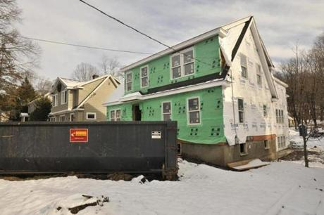 A house in Winchester, sited between two houses were of similar era and size is now undergoing extensive changes under the direction of the Beantown Property Group, owners of the home and leading the rehabilitation and flipping project.