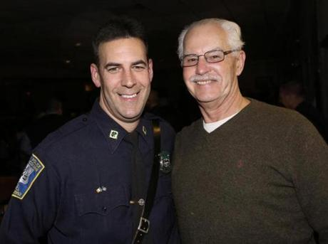 1-19,2013 West Roxbury, Mass. Over 600 guests attended the Hurricane Sandy Relief benefit for NYPD Pipes and Drums, sponsored by the Boston Police Gaelic Column held at the West Roxbury Irish Social Club. L. to R. are Boston Police Gaelic Column member Boston Police Det Tom Leahy and his dad retired Boston Police Sgt. Jim Leahy both of Dorchester. Globe photo by Bill Brett