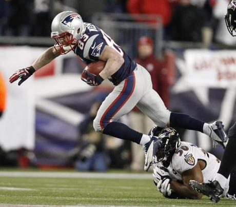 New England Patriots wide receiver Wes Welker escapes the tackle of Baltimore Ravens outside linebacker Albert McClellan during the first half.