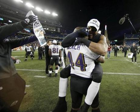 Baltimore Ravens linebacker Ray Lewis (right) celebrates with Vonta Leach.