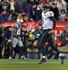Ravens quarterback Joe Flacco appears to be walking on air as he celebrates a touchdown pass to Anquan Boldin.