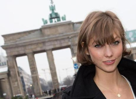 "Supermodel Karlie Kloss's ""chop,"" with wispy bangs, has been deemed today's in-demand look."
