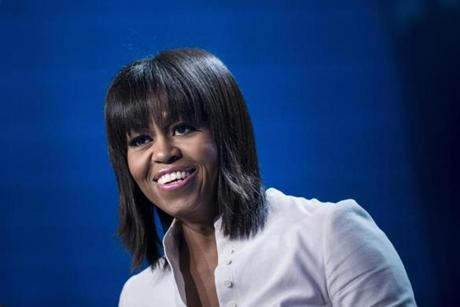 First Lady Michelle Obama, sporting a new hairstyle, spoke during the Kids' Inaugural concert at the Washington Convention Center.