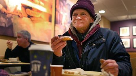 Wayne Gilchrist, who says he is homeless, made a modest donation for his coffee and French bread with butter.