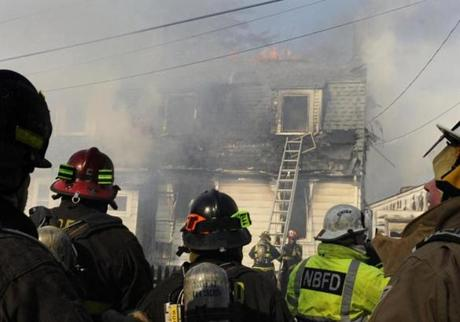 Firefighters from several towns batttled a house fire in Barre that killed an elderly woman. Officials are investigating fires in seven Massachusetts communities.