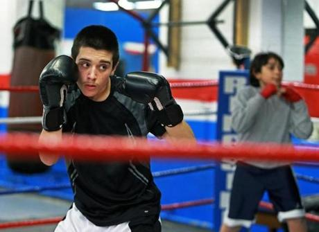 Anthony Rego, 14, left, and Anthony Samayoa, 11, are among the young boxers who work out at the Somerville Boxing Club.
