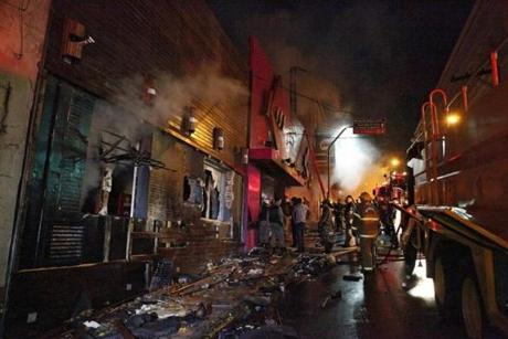 A handout photo released by the RBS Agency shows firefighters trying to extinguish a fire that broke out at the Kiss nightclub. The fire is believed to have started after a performing band lit fireworks.