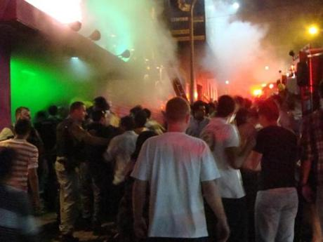 A crowd stood outside the Kiss nightclub during a fire inside the club in Santa Maria city, Rio Grande do Sul state, Brazil on Jan. 27. A blaze raced through the crowded nightclub in southern Brazil early Sunday, killing 245 people as the air filled with deadly smoke and panicked party-goers stampeded toward the exits, police and witnesses said. It appeared to be the world's deadliest nightclub fire in more than a decade.