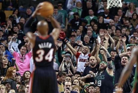 Boston, MA: 01-27-13: Boston fans (with the exception of one Heat jersey wearer) try to distract former Celtics (now Miami) guard Ray Allen as he shoots a first half free throw. The Boston Celtics hosted the Miami Heat in an NBA regular season game at the TD Garden. section:sports topic: Heat-Celtics (Globe Staff Photo/ JIm Davis