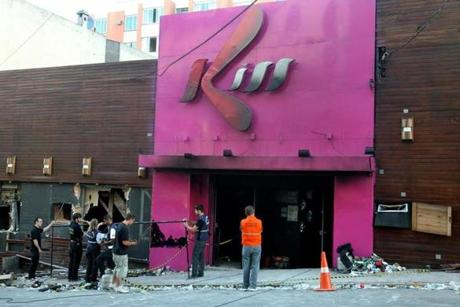 Police investigators inspect the entrance of the Kiss nightclub in Santa Maria city, Rio Grande do Sul state, Brazil, Sunday, Jan. 27, 2013. Flames raced through a crowded nightclub in southern Brazil early Sunday, killing more than 230 people as panicked partygoers gasped for breath in the smoke-filled air, stampeding toward a single exit partially blocked by those already dead. (AP Photo/Nabor Goulart)