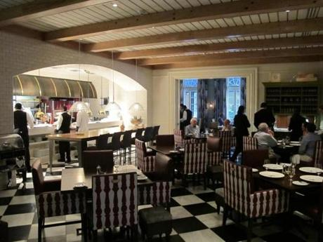 06travorleans - The dining room at R'evolution, a serene oasis just paces away from the Bourbon Street frenzy, features a prime view of chefs John Folse and Rick Tramonto's kitchen. (Liza Weisstuch)