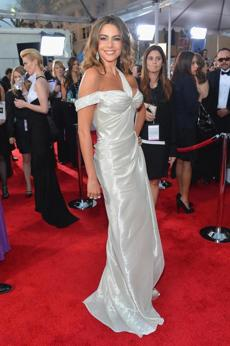 "Sofia Vergara Thewhite liquid lame gown marks a turningpoint for the ""Modern Family"" actress. The dress may not have been ideal, but at long last the focus was on the dress rather than her décolletage."
