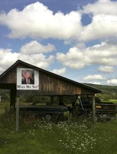 A picture of former President George Bush hung along a country road in rural Vermont.