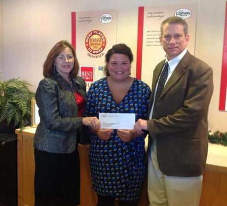 Conway Director of Relocation Dawn Stevens (left) and CFO Bryan Keaney present Shannah Paddock of the Alzheimer's Association a check from the company's participation in the South Shore Walk to End Alzheimer's.