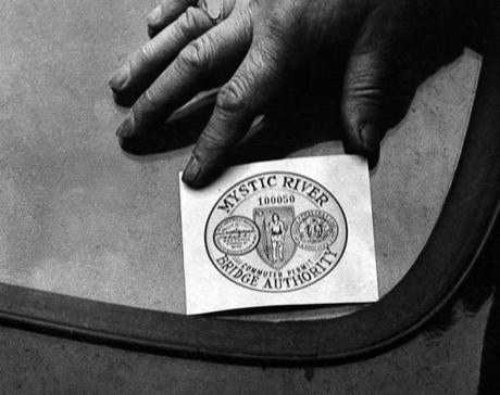 February 14, 1950: The original Mystic Bridge decal cost 50 cents and was good indefinitely. Without the decal, it cost a motorist a 15-cent toll every time the bridge was crossed. With a decal the toll was only 10 cents. The decal was stuck on the outside of the windshield, moistened and pulled off leaving the imprint on the glass. Each had a number and the decal came in two sizes. One three inches in diameter went on the right of the rear window. A smaller one could be placed on the right ventilator window.