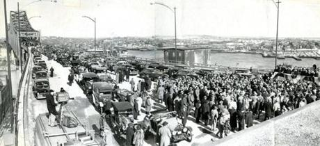 February 25, 1950:  A parade of 100 cars from the State House preceded the ceremonies at the dedication of the new bridge. In the foreground could be seen some of the old autos which participated. At the right is the viewing stand where the flag was raised. Gov. Paul A. Dever cut the ribbon on the new bridge and called the completion of the bridge,