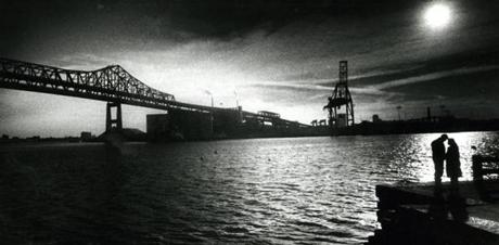 January 14, 1989:  A couple shared a quiet moment alone at Admiral's Hill in Chelsea with the Tobin Bridge in the background. The Mystic River Bridge was renamed the Maurice J. Tobin Memorial Bridge on June 14, 1967. Tobin was Governor of Massachusetts from 1945-47 and also served as Secretary of Labor in President Truman's cabinet.