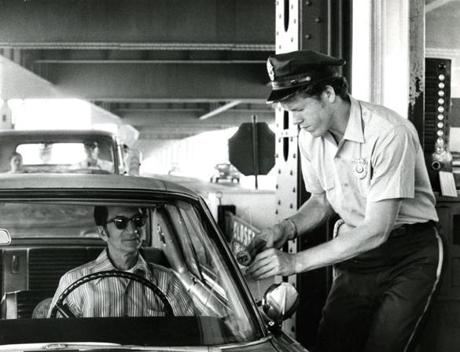 June 21, 1971: A Tobin Bridge tolltaker was seen applying a new sticker to a car. New $2 stickers went on sale after Suffolk Superior Court Judge Reuben L. Lurie refused to issue a restraining order which would have prevented the increase by the Massachusetts Port Authority. The stickers, now good for only a year, entitled motorists to pay 15 cents instead of 25 cents every time they used the bridge.