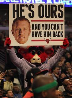 Benny the Bull, the mascot of the Chicago Bulls, held a sign behind the Celtic's bench with a photo of former Celtic player Scalabrine.