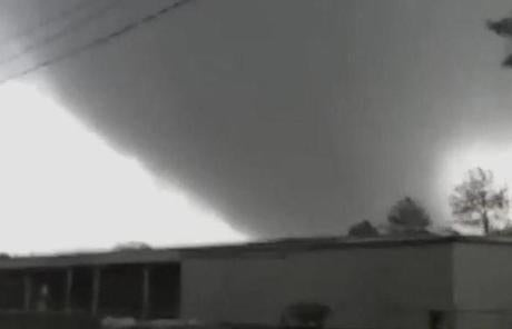In this image made from video and released by WSB TV in An video still image shows a tornado as it moved through the town of Adairsville, Ga.