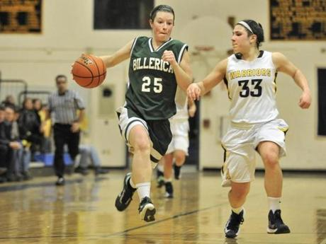 Billerica High girls' Shannon Hayes, (25), and Andover Captain Jackie Alois, (33) during matchup against three-time defending state champ Andover High.