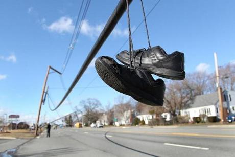Danvers, MA., 01/31.13, Andover STreet had downed power lines, forcing business to close due to the storm. Athletic shoes dangles close to the ground on downed lines. Section: Metro Suzanne Kreiter/Globe staff