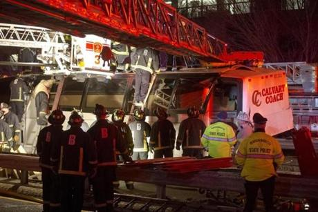 The impact with the overpass pushed in the front of the roof of the bus, a Boston Fire Department spokesman said.