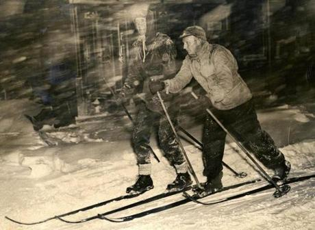February 14, 1940: These two skiers made good use of the heavy snowfall as they skied on Washington St. in front of the Boston Globe building in downtown Boston. L-R is Sven Cederstrom, a member of the Appalachian Mountain Club, and Bjarne Bremer, both of Beacon Hill.