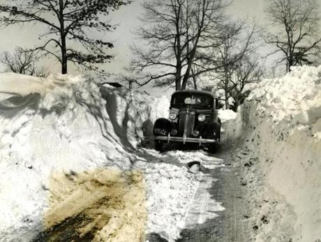 February 15, 1940: Snow was higher than the tops of cars in places along Route 27 in Medfield. And the road was none too wide either.