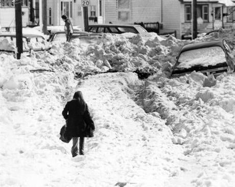 A woman treaded through snow on Dolphin Avenue in Revere.