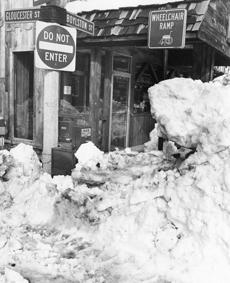 Snowbanks were many feet high along Boston's roads.