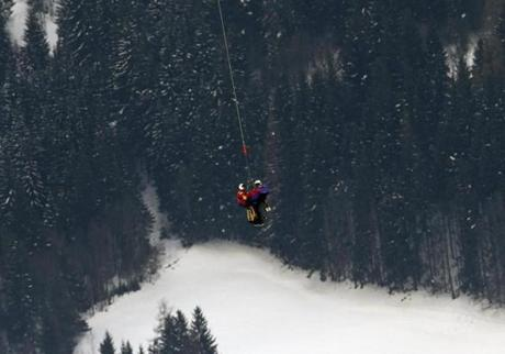 The temperature was about 30 degrees as Vonn was airlifted above the trees of the Austrian mountains.