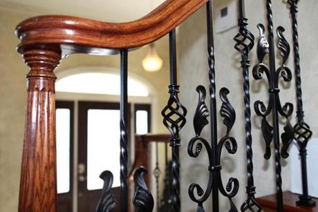 The railing going to the second floor is ornate.