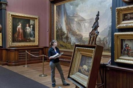An art student from St. Johnsbury Academy visits the art museum at the Athenaeum, which includes a gallery with Hudson River School paintings.
