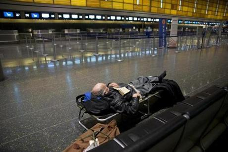 Peter Simons, 65, waiting for his flight to Paris, was stranded in the International Terminal E at Logan Airport on Feb. 8, but he did get a cot.