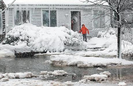 Water closed in on Andrea Giacomozti and her daughter Gavin of Turner Road in Scituate.