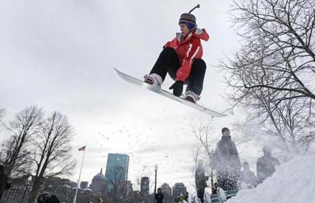 A snowboarder caught some air on Boston Common.