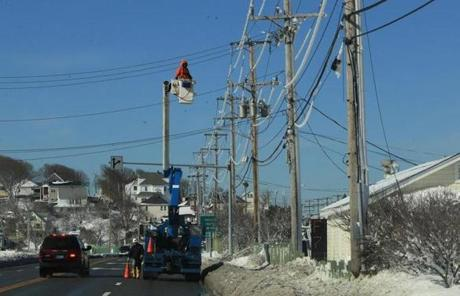 A utility worker checked out ice-covered power lines in Hull.
