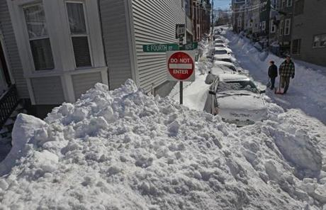 Snow was piled high at the intersection of East Fourth Street and Pacific Street in South Boston.