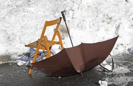 An umbrella and a chair served as a parking spot saver in South Boston on Sunday.