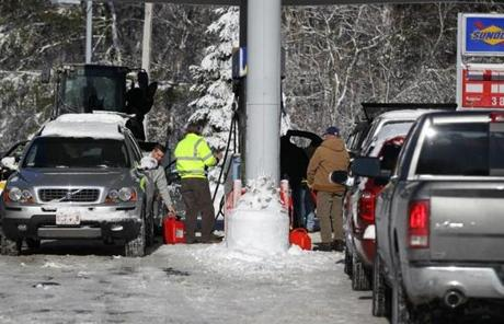 Vehicles lined up at a gas station on Route 3A in Scituate.