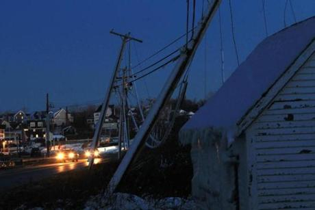 Downed utility poles and wires lined the road near Bert's restaurant on Plymouth Beach.