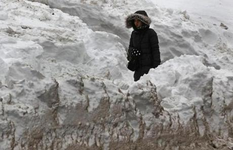 The City of Boston launched an effort Monday to identify and remove massive snow piles.