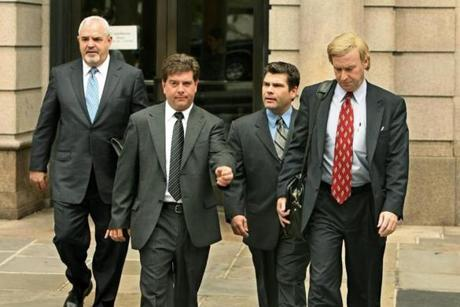 Brothers Michael and Jeffrey Derderian, center left, and center right, depart Superior Court, in Providence, R.I., Friday, May 26, 2006, accompanied by their new attorney, Anthony M. Cardinale, left, and their former attorney, Jeffrey B. Pine, right. Superior Court Judge Francis J. Darigan Jr. approved Pine's request to withdraw as attorney for Jeffrey Derderian. The brothers each face involuntary manslaughter charges for the Feb. 20, 2003 fire at The Station nightclub in West Warwick, R.I. (AP Photo/Andrew Dickerman, Pool) / OUTTAKe 0530