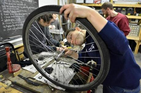 Kathy Kennedy performed an overhaul on a wheel hub in a bicycle maintenance class.